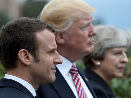 (L-R) French President Emmanuel Macron, US President Donald Trump and Britain's Prime Minister Theresa May.  Picture:  AFP