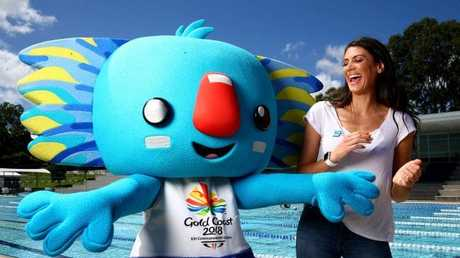 Commonwealth Games medallist Stephanie Rice joins with games mascot Borobi. Pics Adam Head
