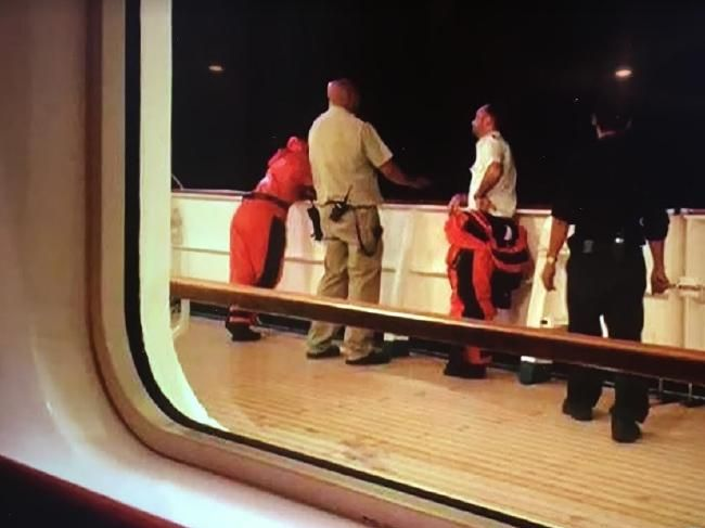 A passenger photographing crew on board Pacific Dawn searching for missing lady. Picture: Supplied