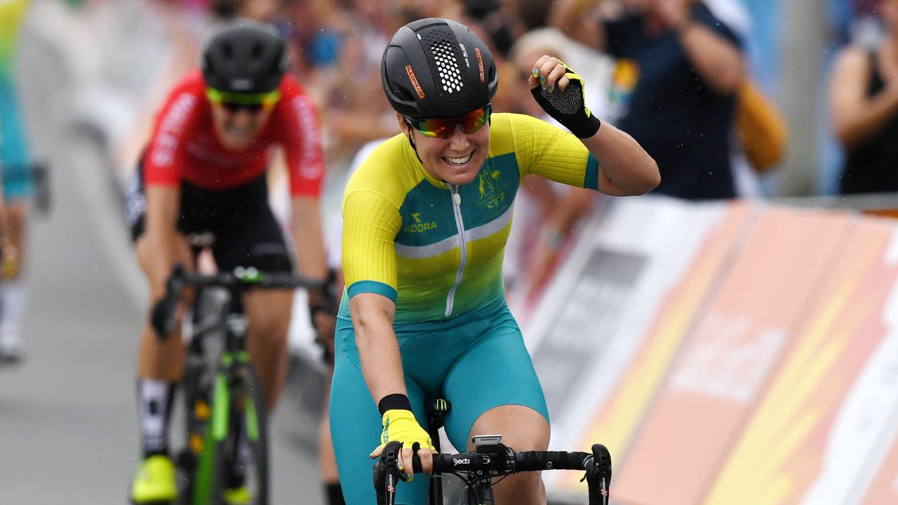 Chloe Hosking of Australia (centre) celebrates winning the women's cycling road race on day 10 of the  Commonwealth Games on the Gold Coast. Picture: Dan Peled/AAP