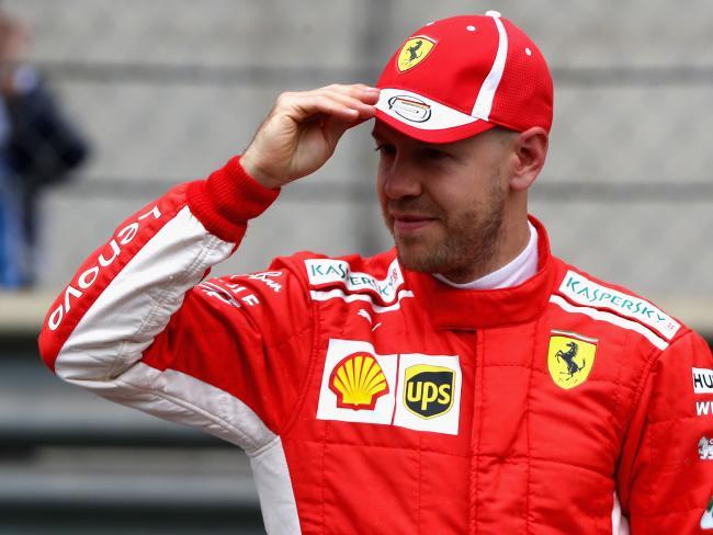 Pole position qualifier Sebastian Vettel of Germany