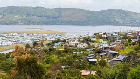 "An ""informal settlement"" overlooks million dollar waterfront properties in Knysna, South Africa."