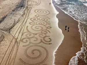 Teenager wows with stunning beach artworks