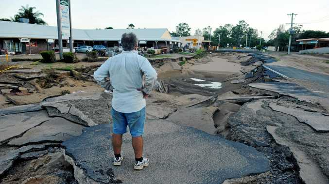 TIME TO ACT: John Luck surveys the massive wash out on Kolan Street which was caused by the record breaking 2013 flood.