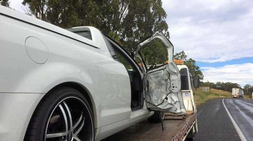 A ute being loaded onto a tow truck.