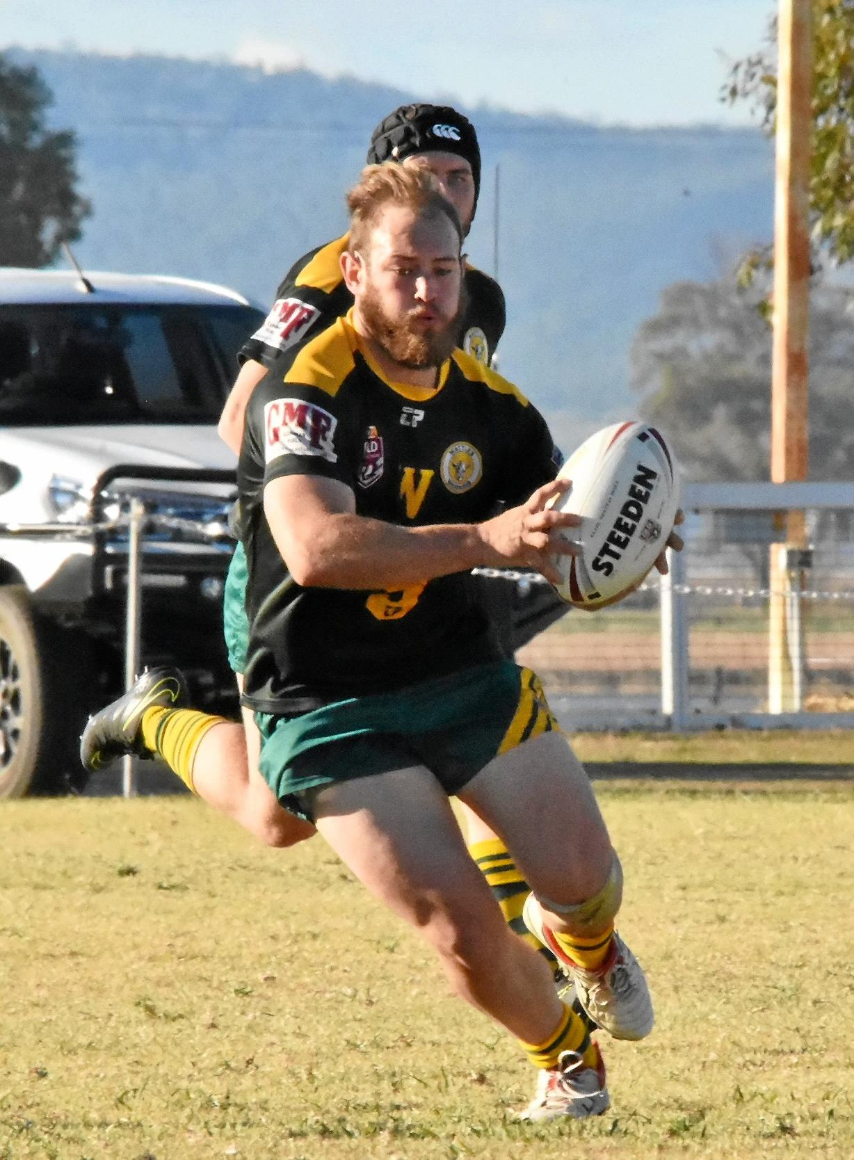 Liam Ross storms forward for Wattles.