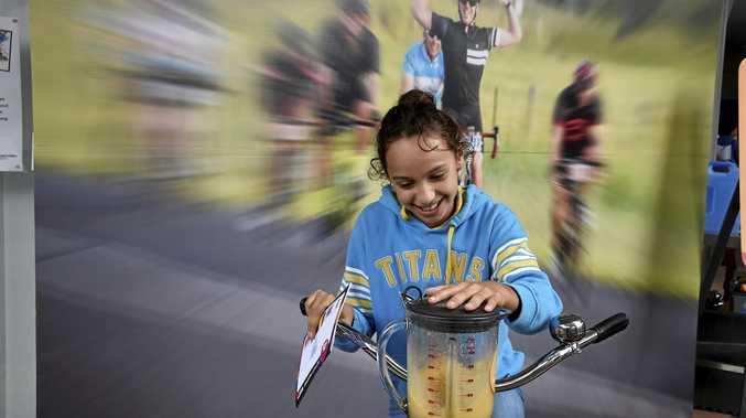 Lekaysha Woodbridge blends her smoothie using a bike.
