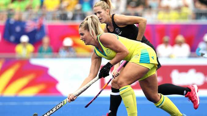 IN ACTION: Ashlea Fey of Australia looks upfield during the gold medal match against New Zealand.