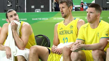 Tasmanians Chris Goulding, left, and Lucas Walker, right, look on during men's gold medal basketball game between Australia and Canada today. Picture: RYAN PIERSE/GETTY IMAGES