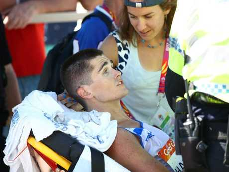 Callum Hawkins of Scotland is given medical assistance after the marathon.