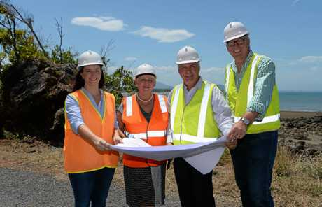 L-R Brittany Lauga, Michelle Landry, Bill Ludwig and Graham Scott look over plans for the upgrade to the Scenic Highway near Statue Bay in 2016.
