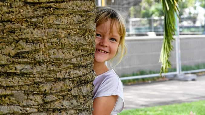 PEEK-A-BOO: Piper-Lee Hickman plays hide and seek with her friends at Alexandra Park on Saturday.