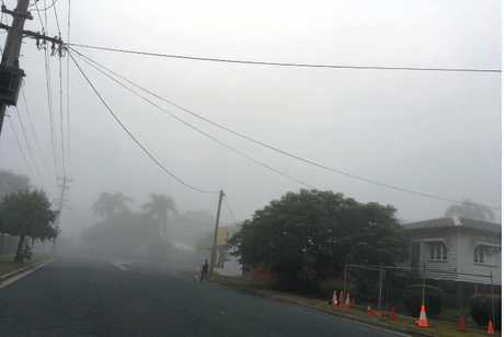 EARLY MORNING: A thick fog covered Rockhampton this morning as commuters made their way to work.