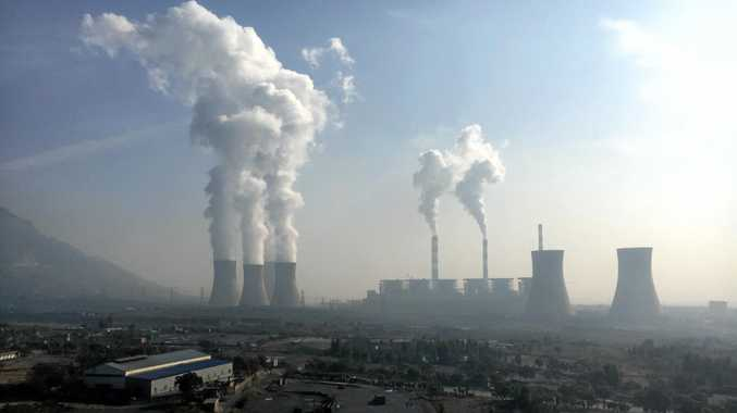 Smoke and steam are discharged from chimneys and cooling towers at a coal-fired power plant in Jiyuan city, central China's Henan province.