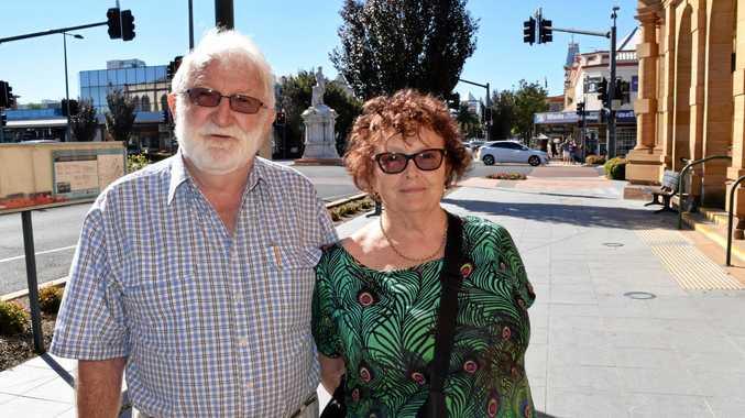 IMPRESSED: Newcastle visitors Stewart and Wendy Ellway admire Warwick's beautiful main street.