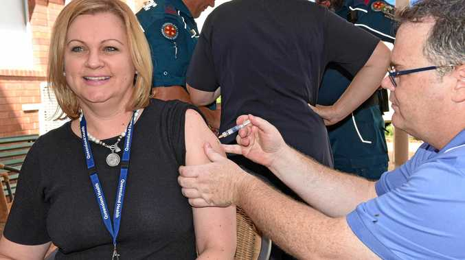 GIVE IT A SHOT: SWHHS chief executive Linda Patat is all smiles as she gets her flu shot from nurse Nigel Barr at the Roma Hospital on Friday.