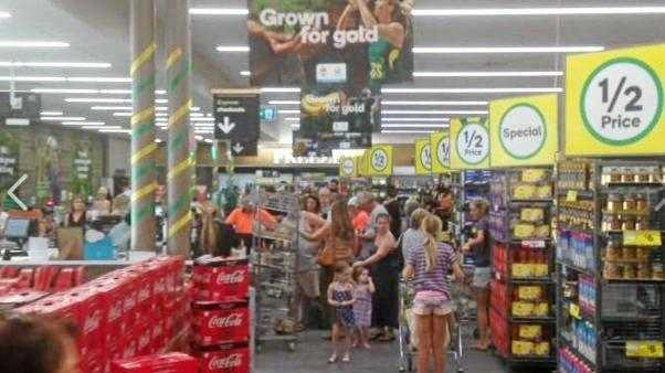 NOT HAPPY: Shoppers lined up at registers crash at Wooloworths stores across the nation.