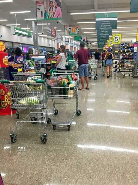 Trolleys abandoned at the Caneland Woolworths registers.