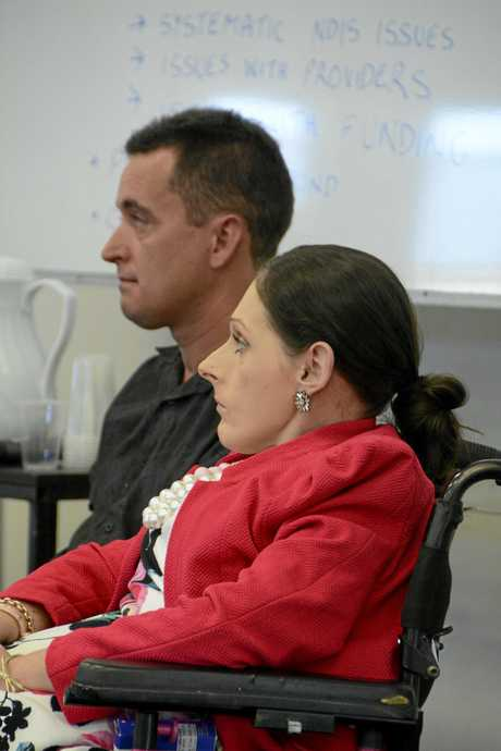 Toowoomba NDIS forum organisers Paul Wilson and Alyce Nelligan sit and watch the guest speakers at the event.