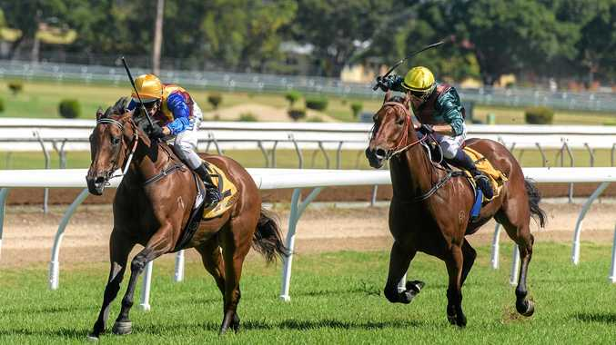 DOWN THE STRAIGHT: Latitude beats home Camillo in Race 1 at Clarence River Jockey Club.