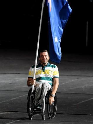 Flagbearer Kurt Fearnley. Picture: AAP / Darren England