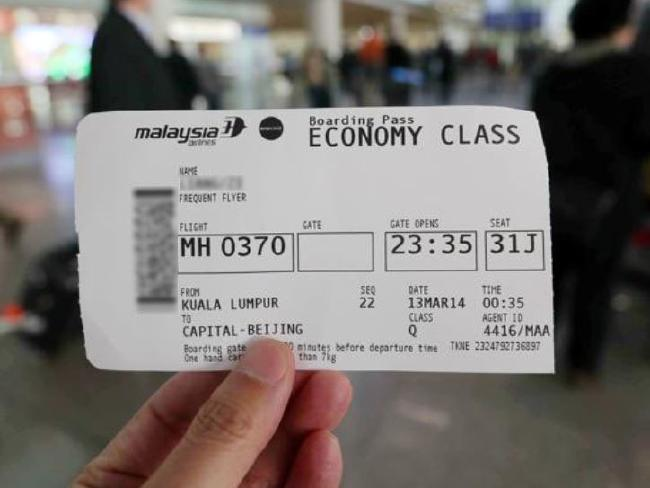 A passenger shows his boarding pass of the last MH370 flight before Malaysia Airlines retired the number in respect to the passengers and crew of missing flight MH370.