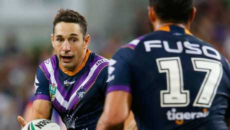 Billy Slater of the Storm passes the ball.