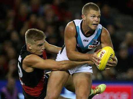 Dan Houston is tackled by Matt Guelfi. (AAP Image/Hamish Blair)