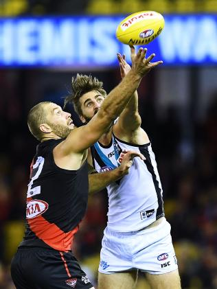 Justin Westhoff goes up against Tom Bellchambers in the ruck on Sunday. Picture: Mark Brake/Getty Images