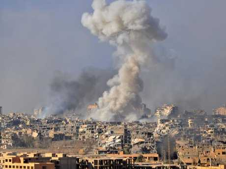 Smoke rises from buildings following an air strike by Syrian government forces in the eastern city of Deir Ezzor. US-led forces bombed pro-Syrian fighters in the area on Feb. 7. Picture: AFP PHOTO / STRINGER