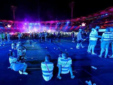 Aussie athletes sit at last night's Closing Ceremony. Picture: Darren England