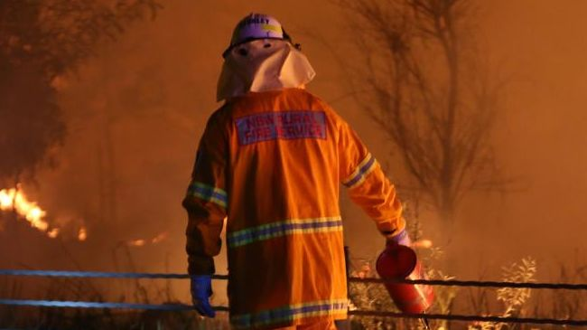 Just before 3am RFS firefighters attended Ella Ave Barden Ridge, put in a back burn to stop fire progression towards houses. Burn was put in along the road and allowed to burn into the valley under the watchful eye of RFS firefighters. Picture: Dean Asher