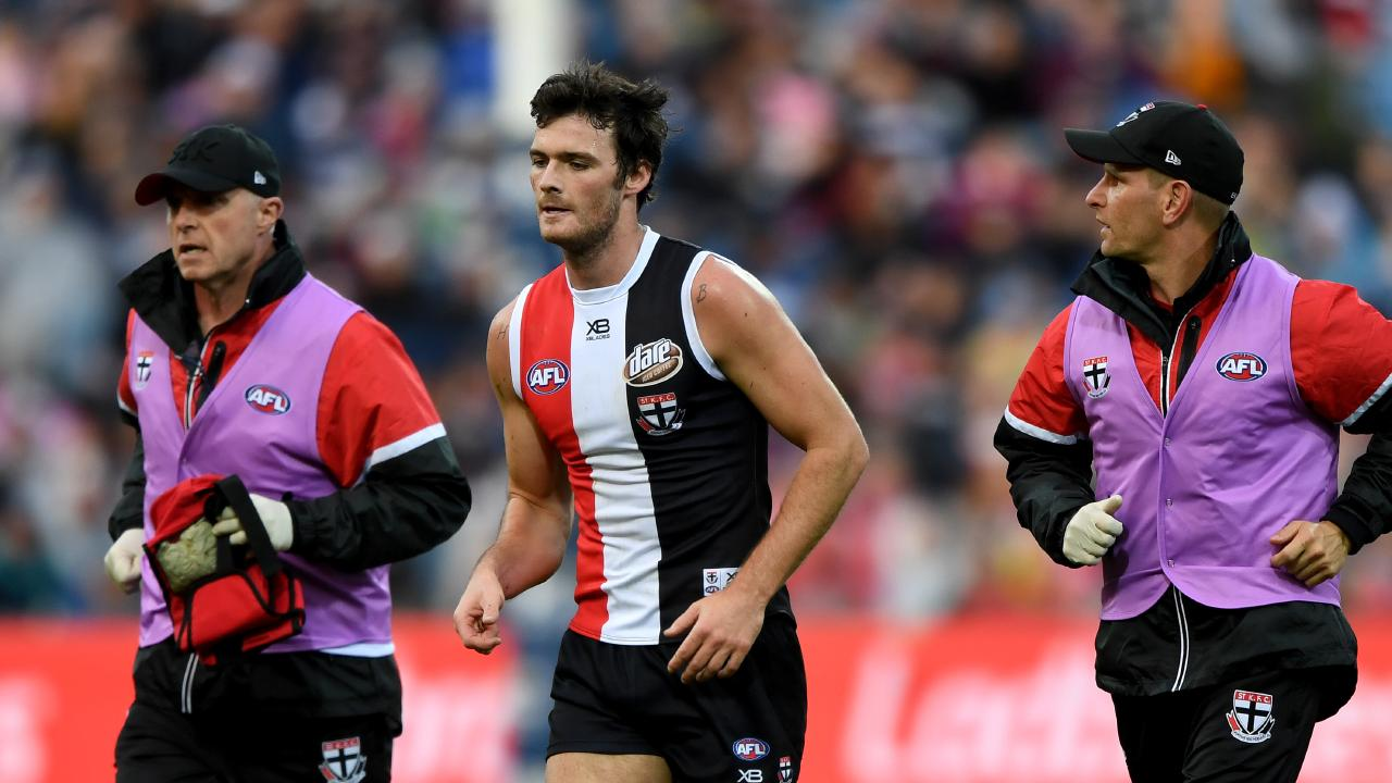 A groggy Dylan Roberton is taken off the ground after his collapse at Kardinia Park on Sunday. Picture: AAP Image/Joe Castro