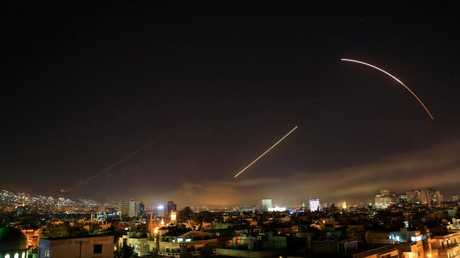 Missiles streak across the Damascus skyline as the US. launches an attack on Syria targeting different parts of the capital. Picture: AP /Hassan Ammar.