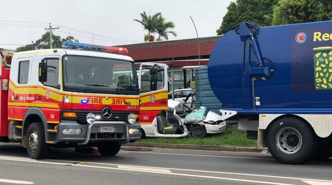 A woman has been cut from her car after a crash involving a Fraser Coast Regional Council dump truck.