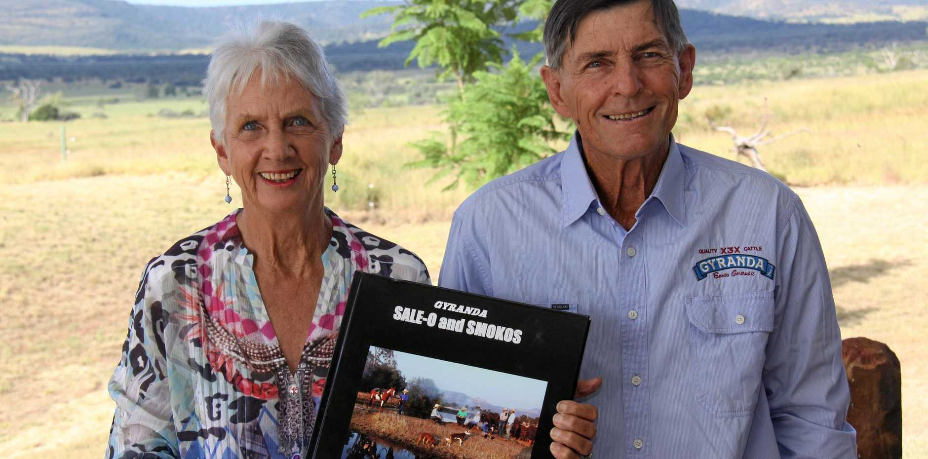 Louise Joyce with her husband Burnett and the copy of the coffee table book she will be releasing at Beef Australia 2018.