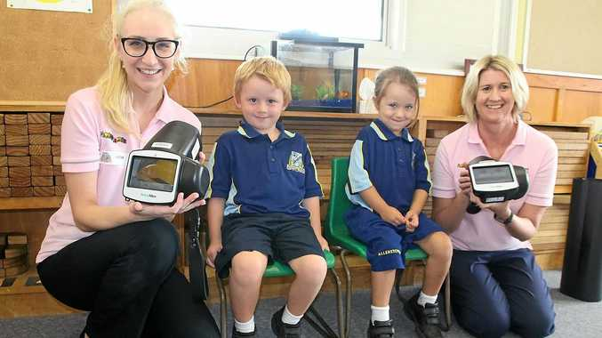 CLEAR VISION: Christine Warner and Brooke Phillips vision screening Allenstown State School prep students Joshua and Renee.
