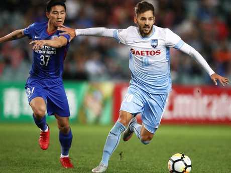 Sydney's FC's Milos Ninkovic pushes off Sun Shilin of Shanghai Shenhua on Tuesday night,