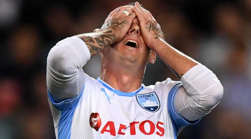 Sydney FC defender Luke Wilkshire after his shot went narrowly wide on Tuesday night.