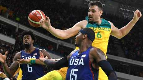 Andrew Bogut battles DeAndre Jordan and Carmelo Anthony during the Rio Olympics.