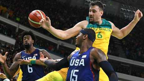 Andrew Bogut battles DeAndre Jordan and Carmelo Anthony during the Rio Olympics.
