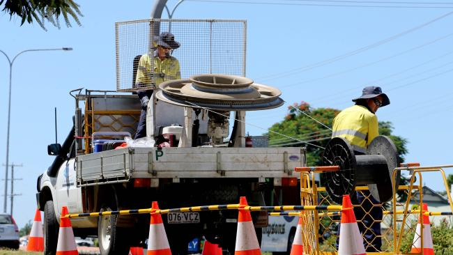 Workers laying/hauling fibre NBN cable. Picture: Chris Higgins
