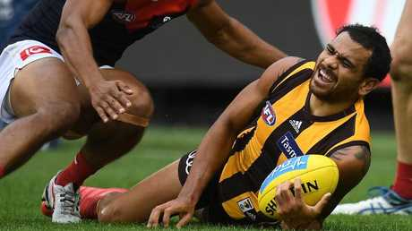 Cyril Rioli feels the pain after injuring his knee against the Demons on Sunday. Picture: Julian Smith/AAP