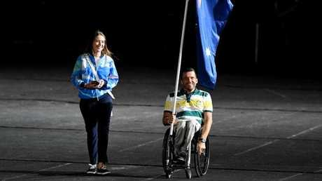 Flagbearer Kurt Fearnley enters the stadium before the start of the closing ceremony of the XXI Commonwealth Games on the Gold Coast, Australia, Sunday, April 15, 2018. (AAP Image/Darren England)