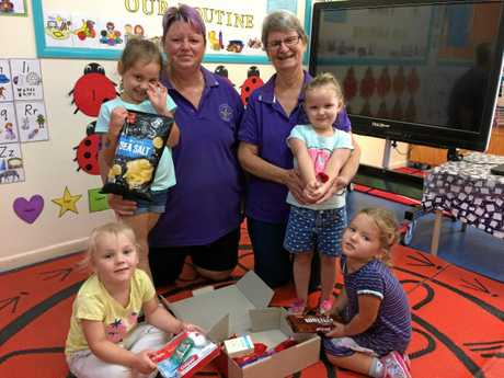 Kids Choice Granville students and staff (from left) Zanntaye, Alexis, second in charge Julie-Anne Kirstenfeldt, assistant Sandra Johnson, Zoe-Lee and Holly helped put together 12 care packages with poppies to send to the troops serving overseas during Anzac Day.