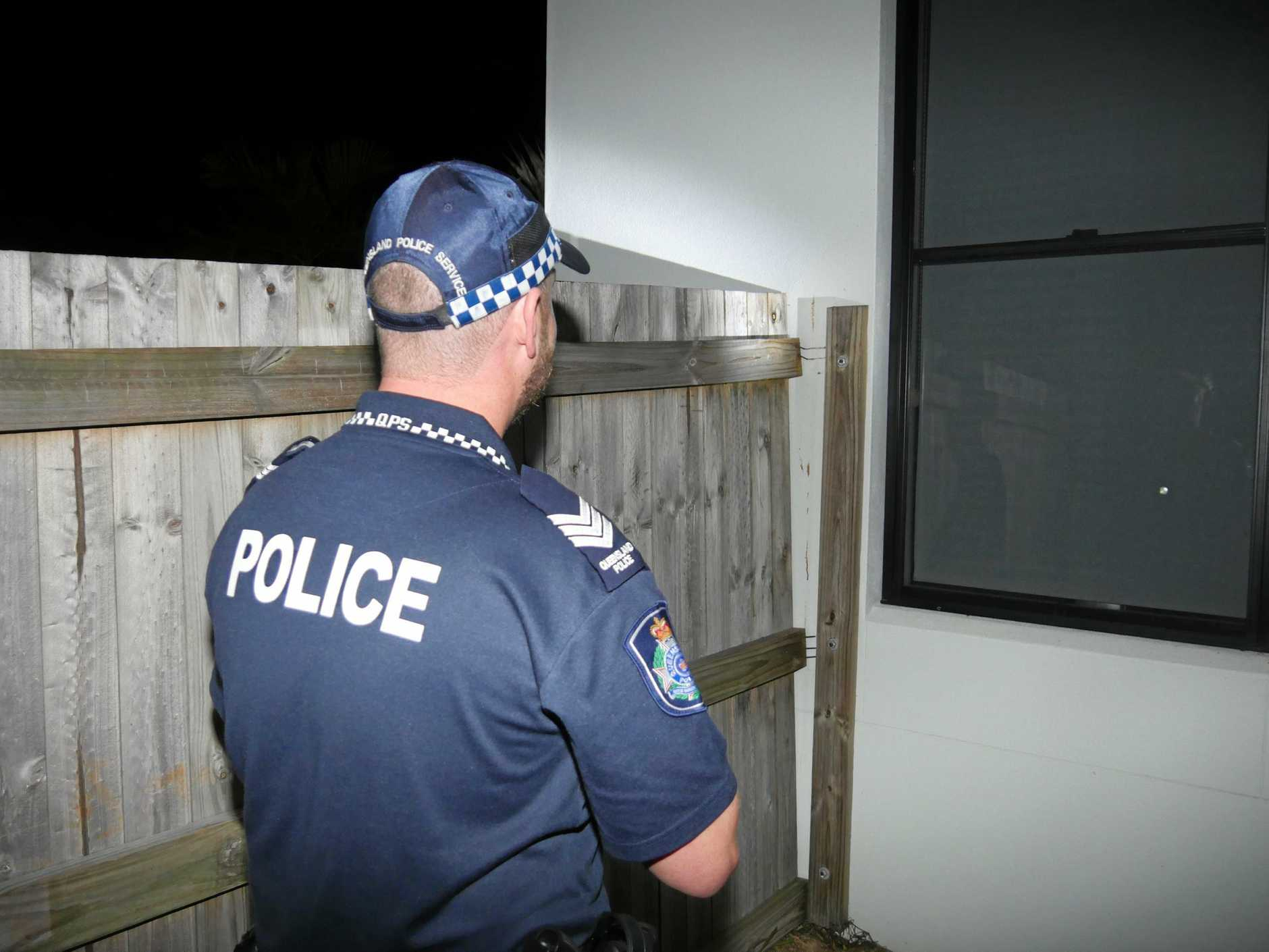 Detective Luke Scells looking for clues at the Cannonvale attempted break in on Friday night.
