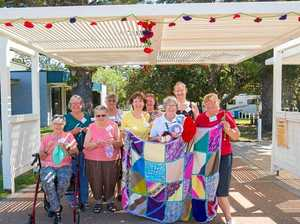 Knitting group purl together to decorate coastal town