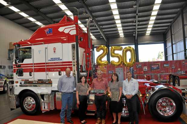 Wickham Freightlines directors take delivery of their 250th new Kenworth truck, from left to right, Haydn Lamb, Kerri-Ann Lamb, Graham Keogh, Donna Keogh and Darren Eather.