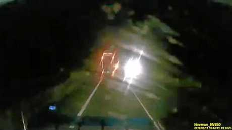 Less than a second after the reckless driver's move, a car sped past in the opposite direction.