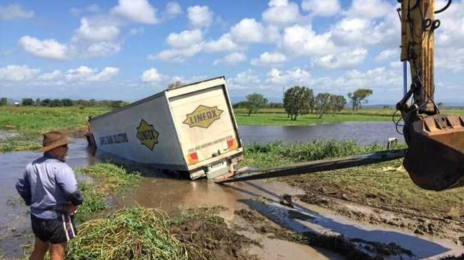 A truck carrying a load of milk has crashed into wetlands near Lethebrook.
